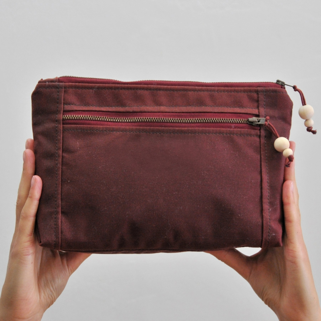Maybe Mabel red wax canvas washbag