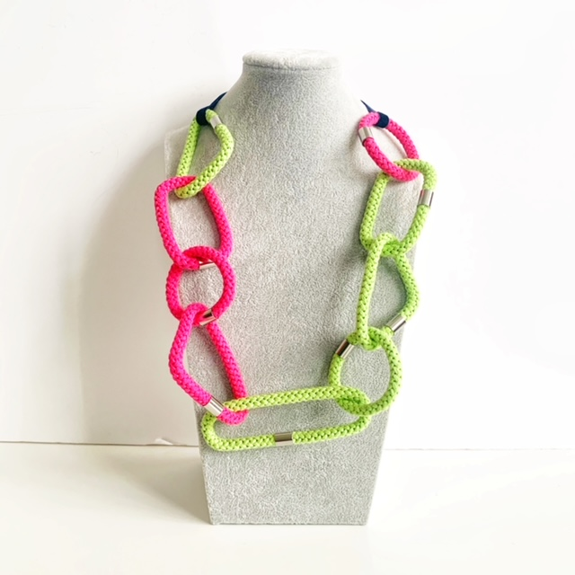 Geometric necklace in pink and green by Handmade by Tinni